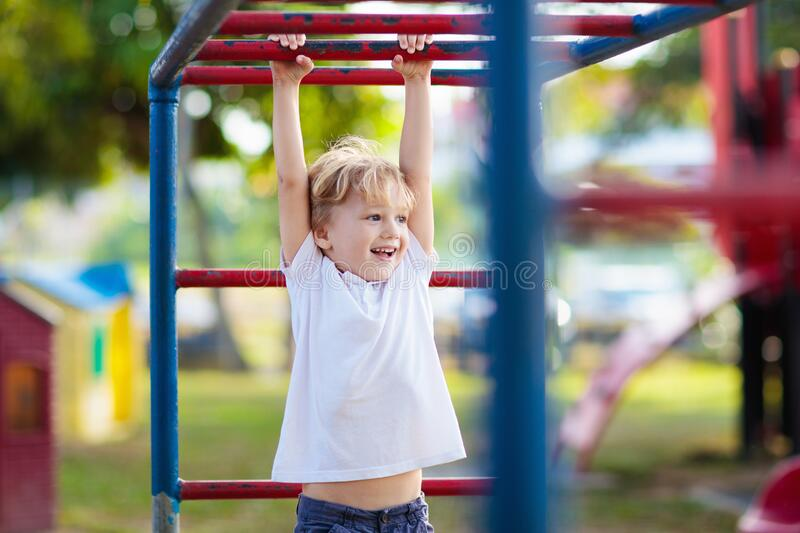 Child on playground. Kids play outdoor royalty free stock images
