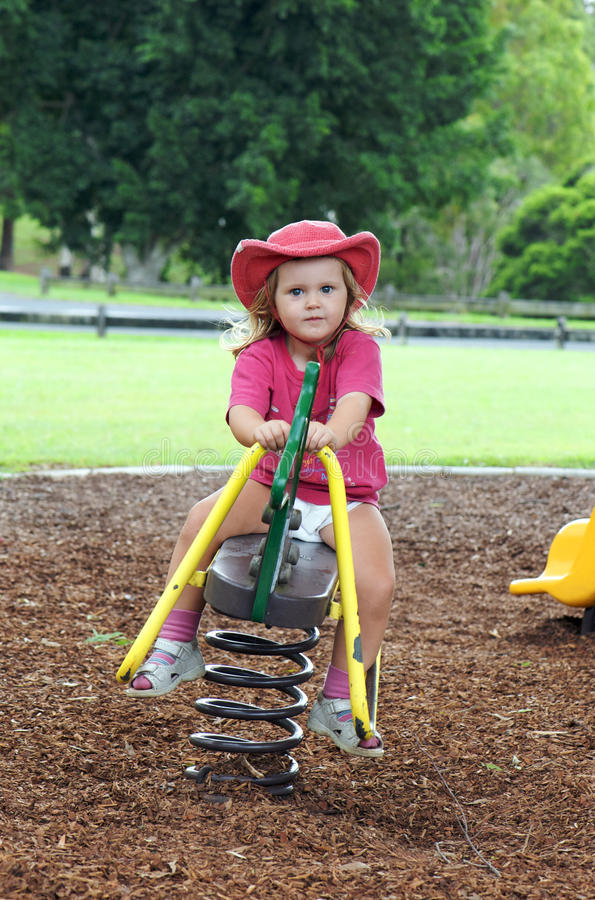 Download Child on playground seesaw stock image. Image of child - 18652391