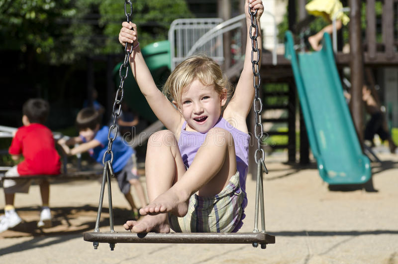Download Child On The Playground Swinging Stock Photo - Image of adventure, happiness: 19201702
