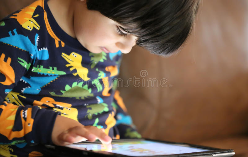 Child playing. Little boy playing on an Ipad