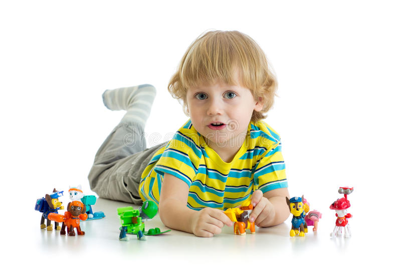 Child playing with animals toys isolated. On white background royalty free stock photo