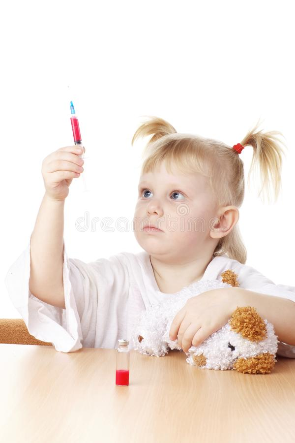 Download Child playing as a doctor stock photo. Image of hospital - 13636662