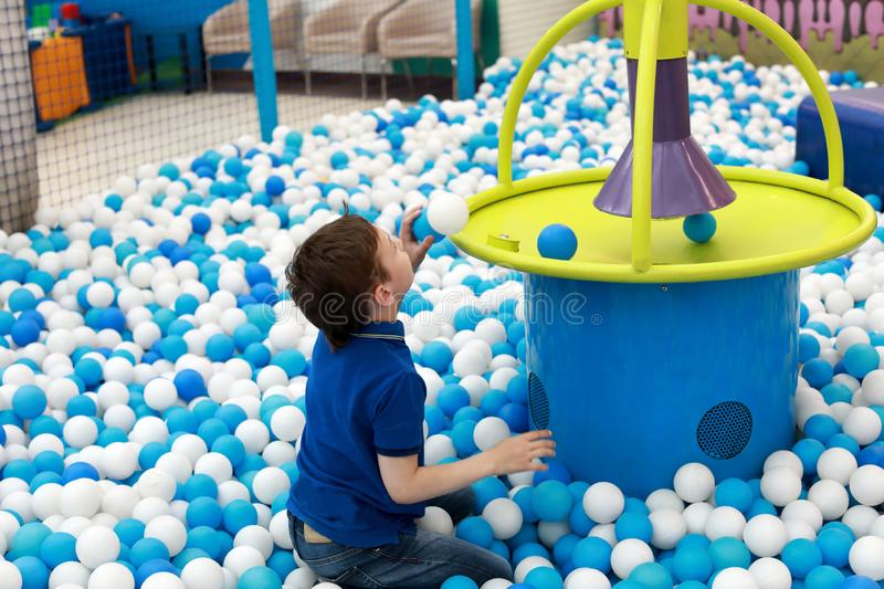 Child playing in ball pit royalty free stock images
