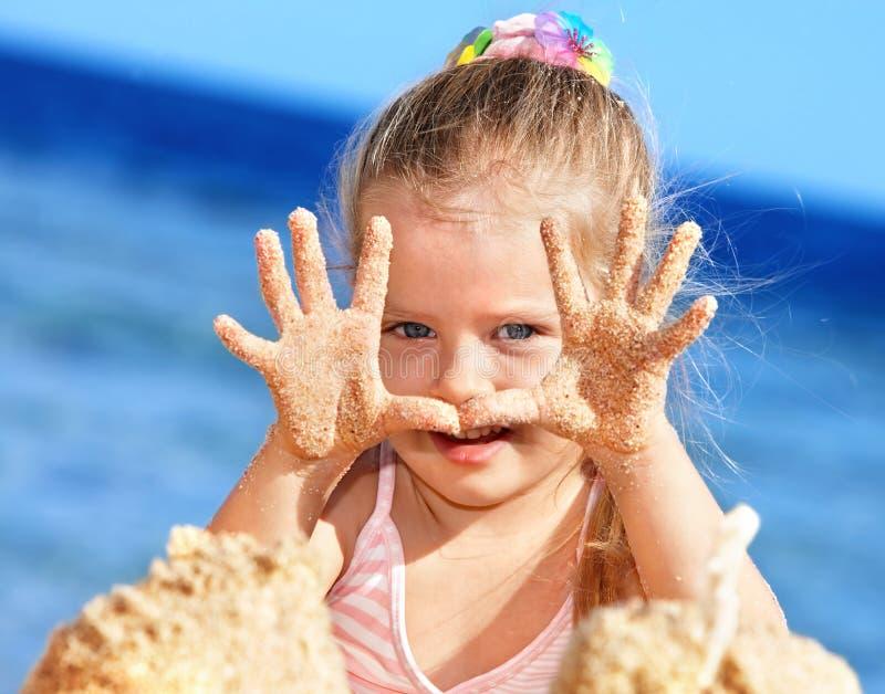 Child playing on beach. stock photo