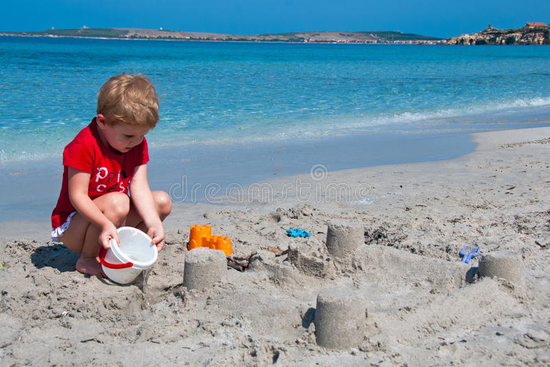 Child playing on beach royalty free stock photo