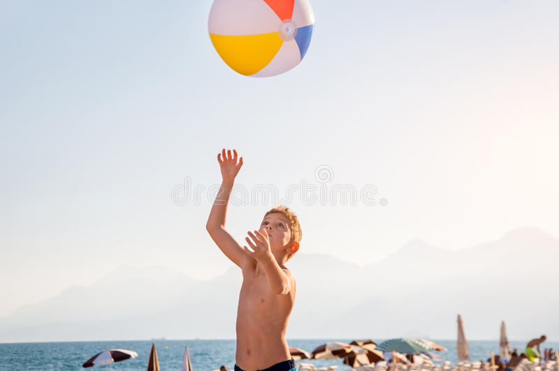 A child playing with beach ball stock image