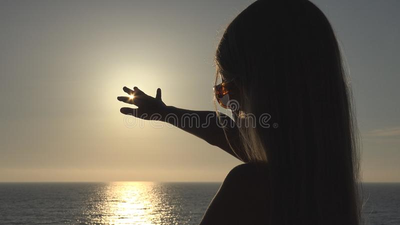 Child Playing on Beach, Kid Looking Waves at Sunset, Girl Silhouette on Seashore stock images