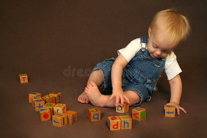 Download Child Playing with Blocks stock photo. Image of play, focus - 4436290