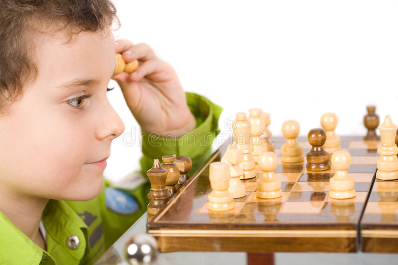 Child playing chess royalty free stock photography