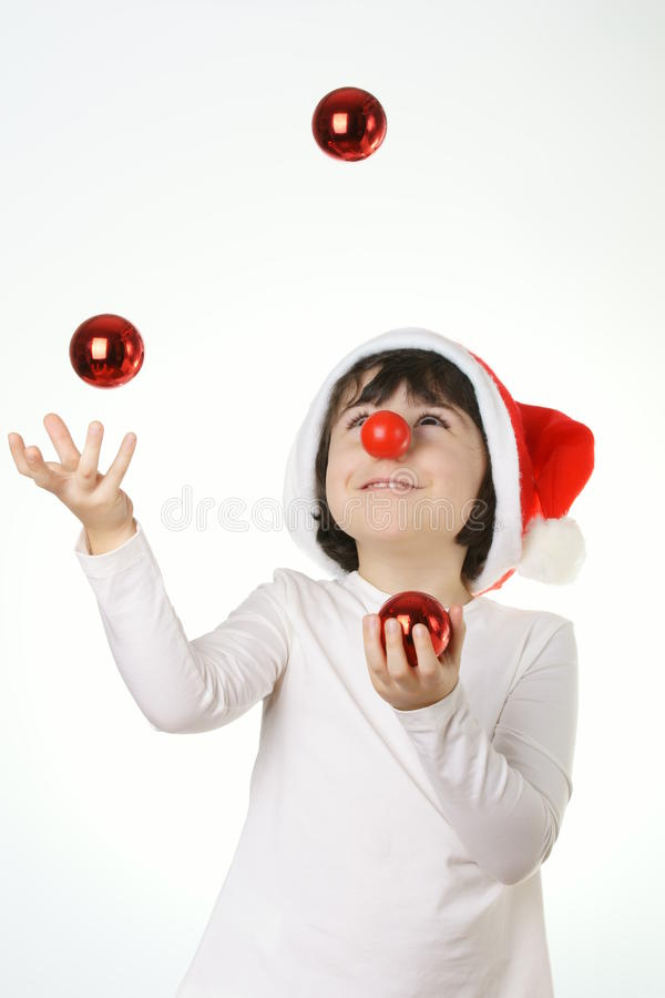 child is playing with christmas decoration royalty free stock photo