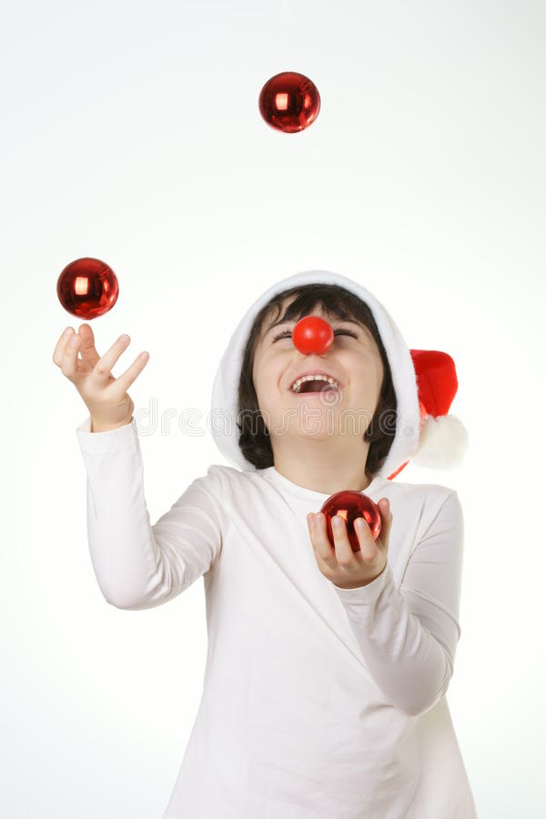 child is playing with christmas decoration royalty free stock photography