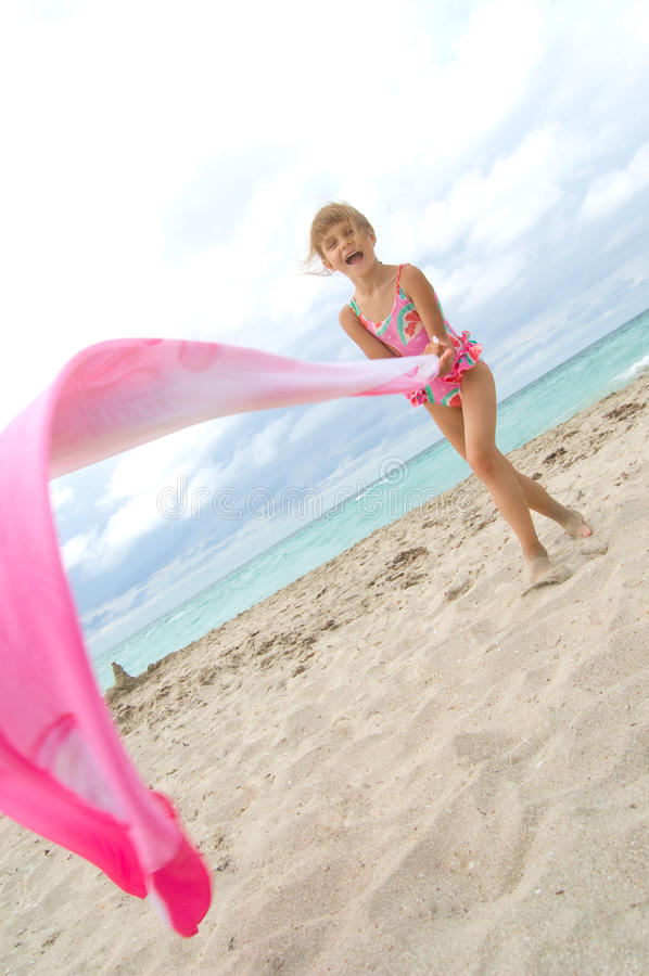 Download Child Playing With A Cloth At The Beach Stock Photo - Image: 15052228