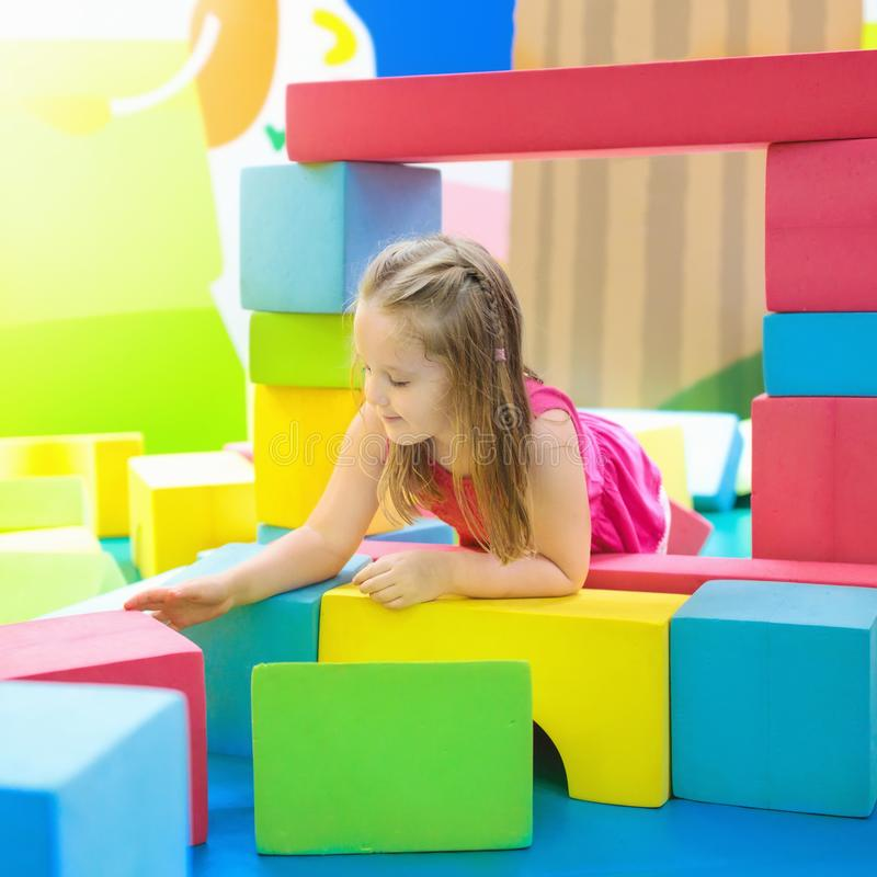 Kids play. Construction toy blocks. Child toys. Child playing with colorful construction toy blocks. Educational toys for young kids. Kindergarten or preschool stock image