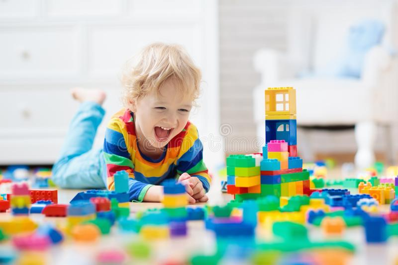 Child playing with toy blocks. Toys for kids. royalty free stock photo