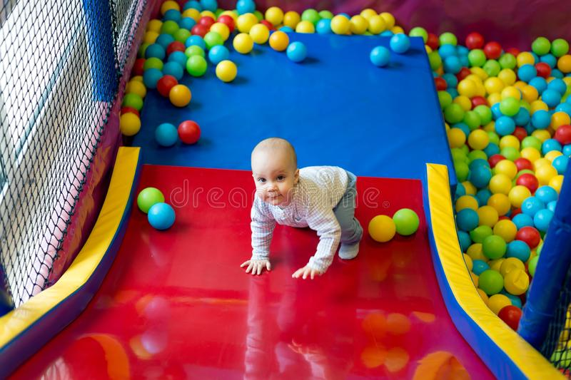 Child playing with colourful balls royalty free stock photography