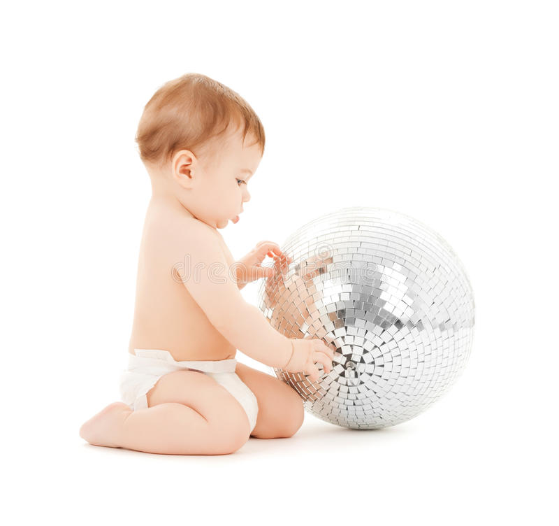 Child playing with disco ball stock photography