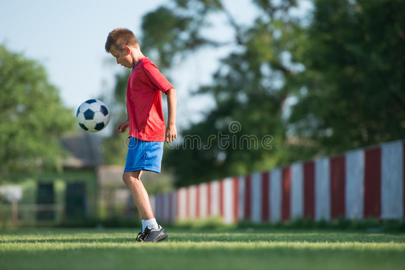 Child playing football stock photography