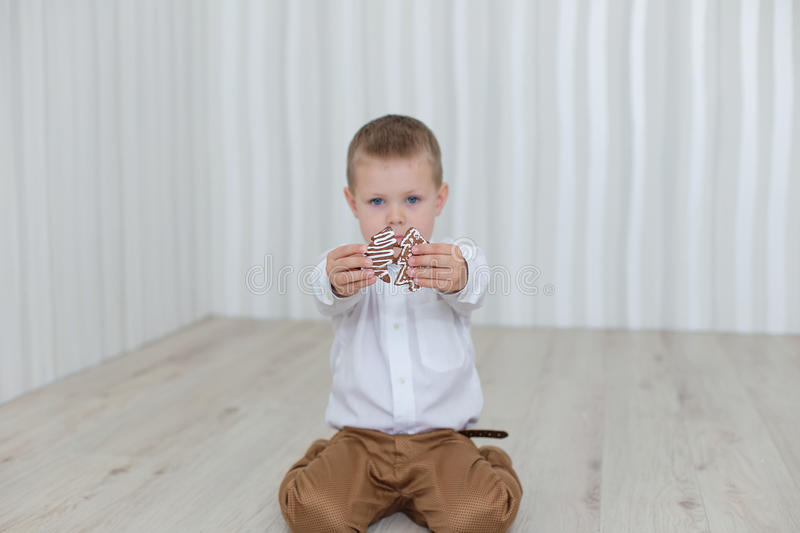 Download Child Playing With Gingerbread New Year`s Eve Stock Photo - Image: 83720545
