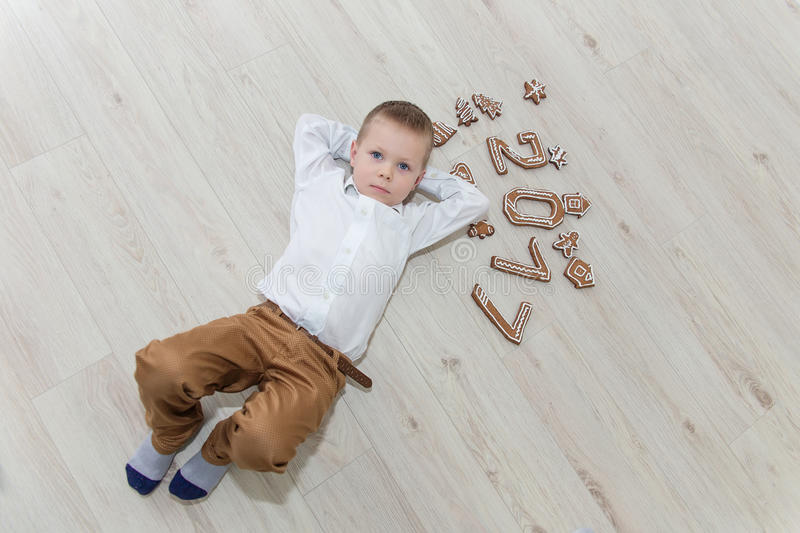 Download Child Playing With Gingerbread New Year`s Eve Stock Photo - Image: 83721210