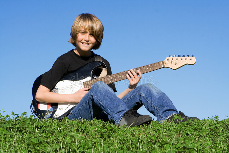 Download Child playing guitar stock photo. Image of hobby, practicing - 5111388