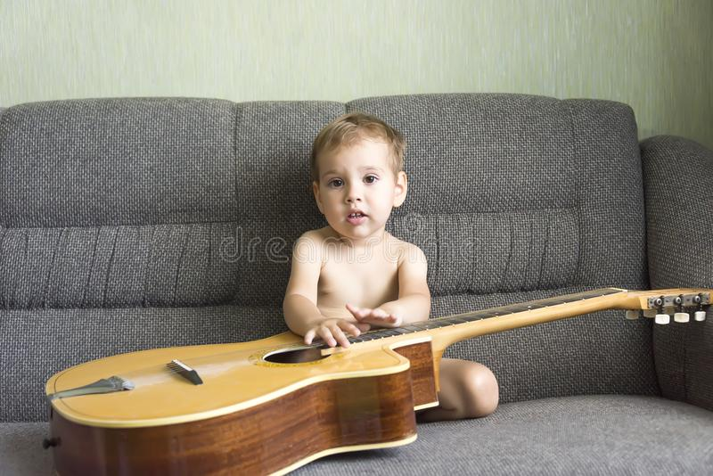 Child playing the guitar royalty free stock image