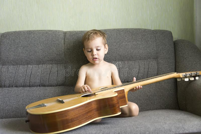 Child playing the guitar royalty free stock photos