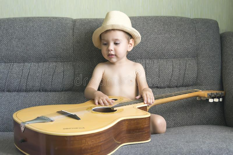Child playing the guitar royalty free stock photo