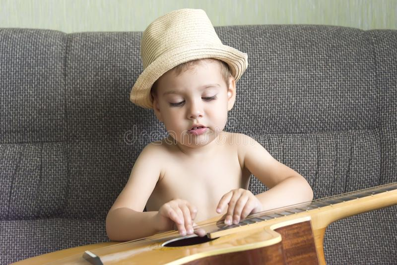 Child playing the guitar royalty free stock photography