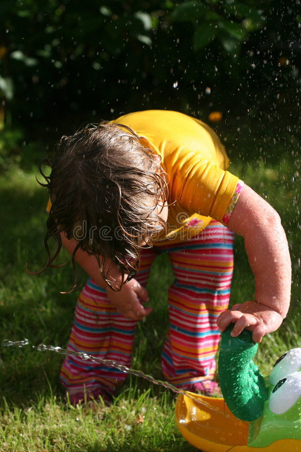 Child Playing On A Hot Summer Day Stock Photo