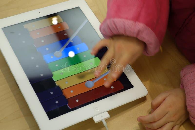 Child playing ipad royalty free stock photos