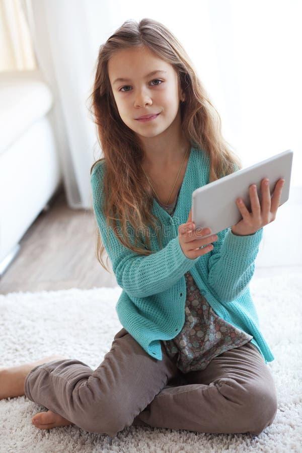 Child playing on ipad stock image