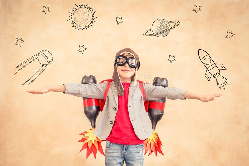 Kid with jet pack at home royalty free stock photos