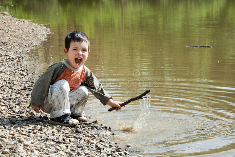 Download Child Playing By The Lake Stock Photos - Image: 24874883