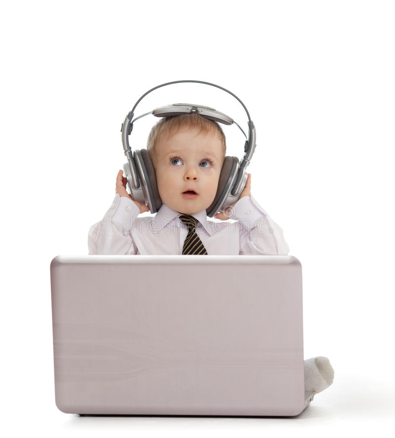 Child Playing With Laptop And Listening To Music Stock ...