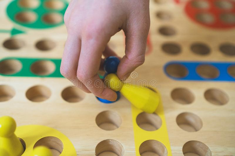 Child playing Ludo board game. royalty free stock photos