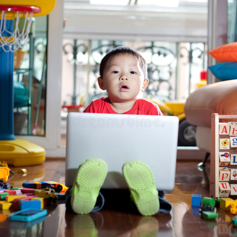 Child playing with notebook stock image