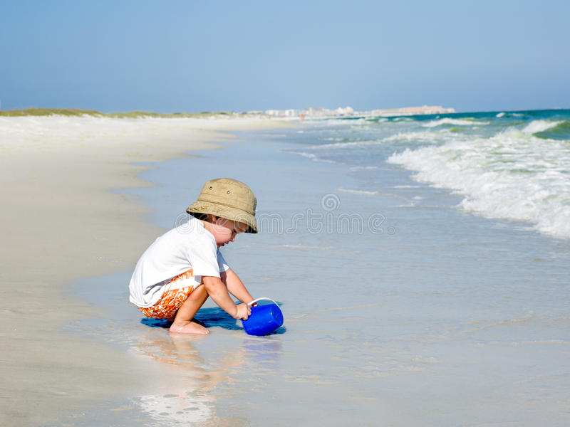Download Child Playing By The Ocean Stock Image - Image: 20647041