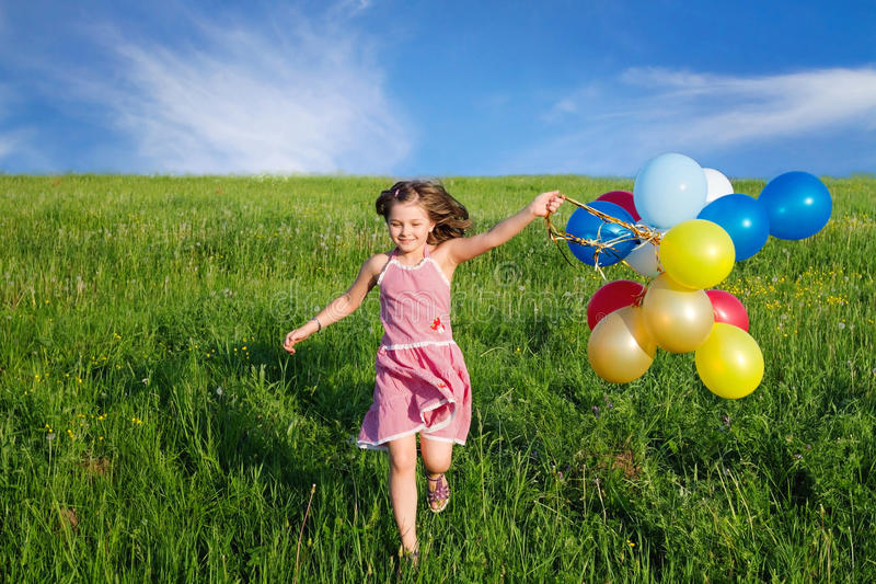 Child playing outdoors stock photography