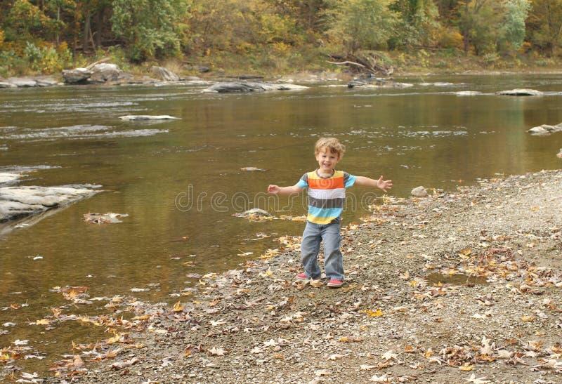 Child playing outside, fall season