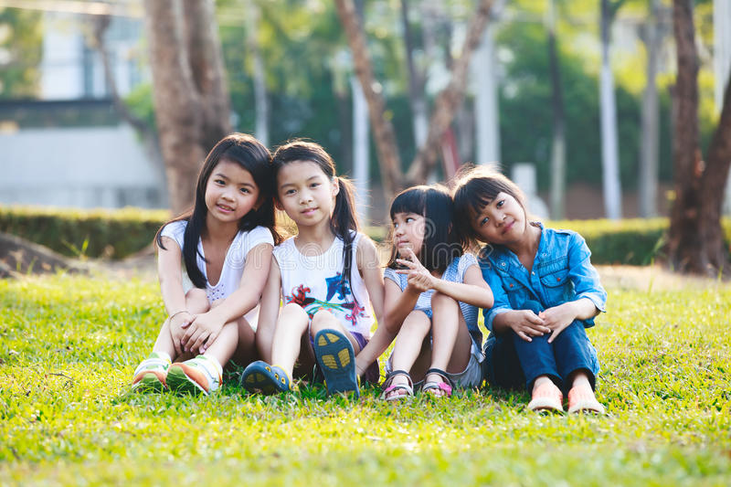 Child playing in park. Four happy smiling child playing in park stock photos