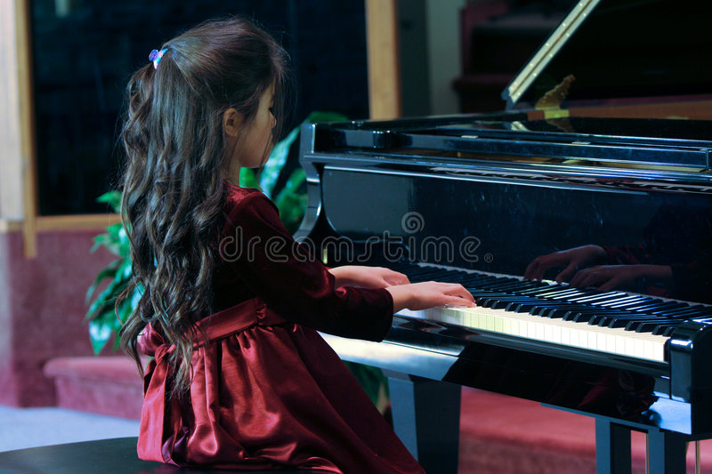 Child playing piano stock images