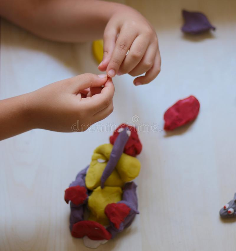 Child playing with play dough royalty free stock photo