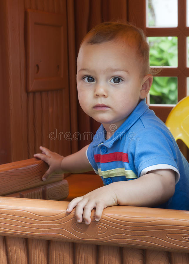 Child playing in playhouse royalty free stock photos