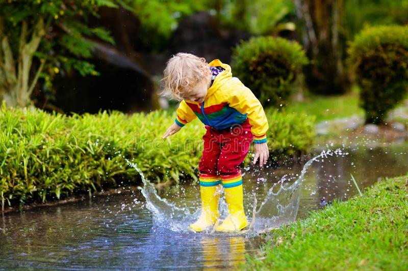 Little Boy, Jumping In Muddy Puddles Stock Photo - Image ...