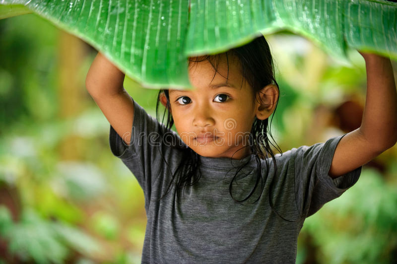 Child Playing in Rain stock photos