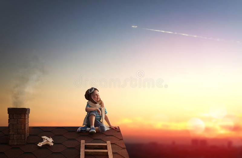 Child playing on the roof stock image