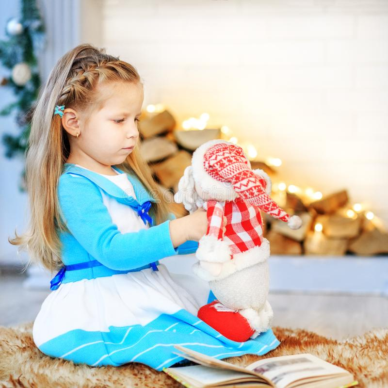 A child playing with Santa. Concept New Year, Merry Christmas, h. Oliday, vacation, winter childhood royalty free stock photo