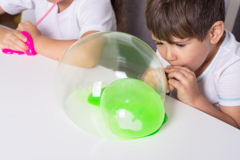 Child playing with slime. Kids squeeze and stretching slime. royalty free stock photos