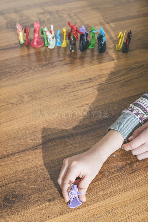 Child playing with small toys. Child playing with small vintage toys on the floor royalty free stock images