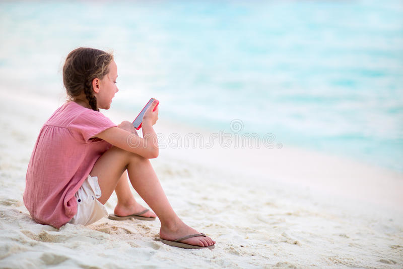 Child playing on smartphone stock image